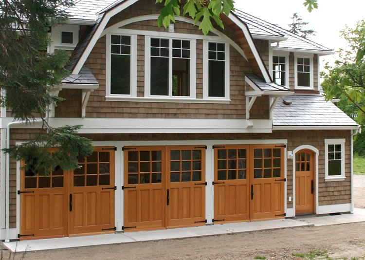 Studio Sargent Carriage Doors (SL07) and the Arched Craftsman Traditional Entry Door (ECTL05-A) in Whidbey Island, WA