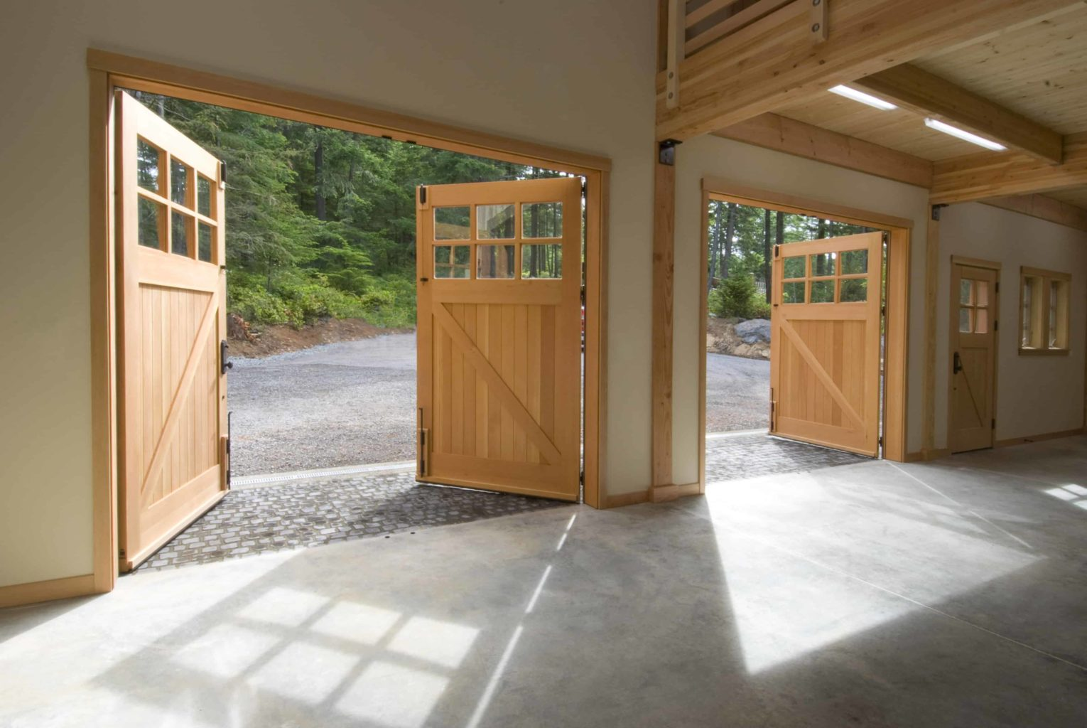 49. CARRIAGE: CL05 Design – Square top, (2x3) lites w/ curved mullions, Z brace w/ tongue + groove panels, Western Red Cedar, w/ bean tip strap hinges & ENTRY: ECL04 Design – Square top, (2x2) lites w/ curved mullions, Z brace w/ tongue + groove panels, Western Red Cedar, w/ butt hinges; Orcas Island, WA