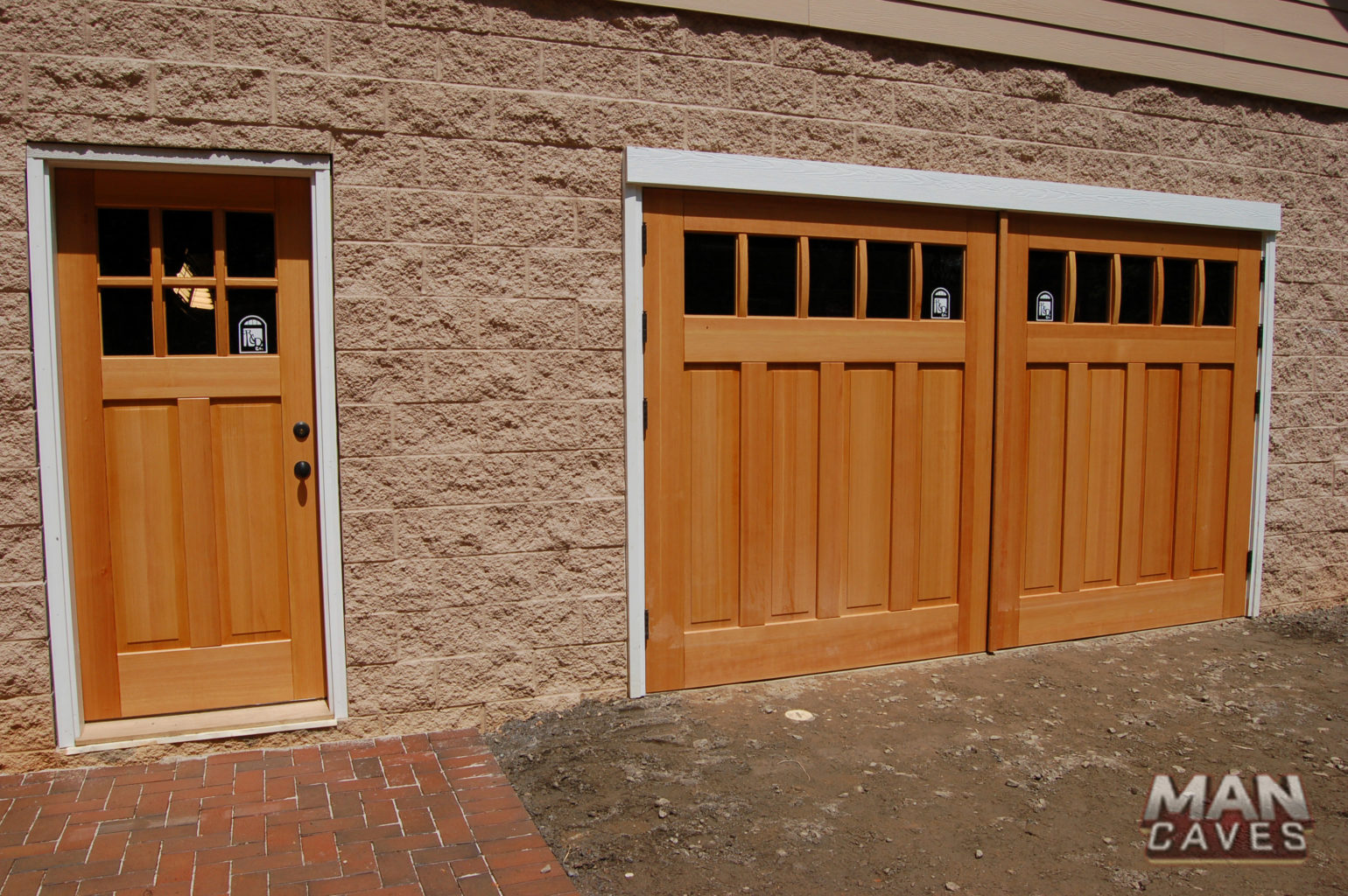 41. Custom Design – Square top, (1x5) lites w/ curved mullions (ext), (4) vertical raised panels, Vertical grain Douglas Fir, butt hinges, and Franklin Auto-swing openers & ECTL05 Design – Square top entry door, (2x3) lites w/ curved mullions (ext), (2) vertical raised panels, Vertical grain Douglas Fir, and butt hinges; Charlotte, N.C. Featured on 'Man Caves'